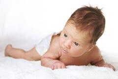 Bebê infantil no branco Fotos de Stock Royalty Free