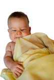 Bebê isolado na cobertura amarela Fotografia de Stock