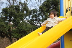 Bebê japonês na corrediça Imagem de Stock
