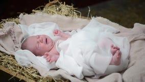 Bebê Jesus no comedoiro video estoque