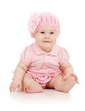 Bebê-menina bonito pequena no vestido cor-de-rosa fotografia de stock