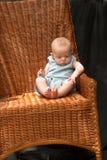 Bebê na cadeira Fotos de Stock Royalty Free