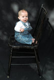 Bebê na cadeira Imagens de Stock