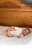 Bebê na cama Imagens de Stock