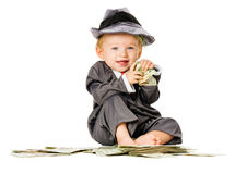 Bebê na pilha de dinheiro Fotos de Stock Royalty Free