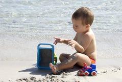 Bebê na praia Imagens de Stock