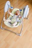 Bebê no balanço eletrônico Imagens de Stock