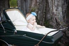 Bebê no carrinho de criança imagens de stock royalty free