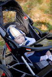 Bebê no carrinho de criança Foto de Stock Royalty Free