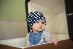 Bebê no carrinho de criança do vintage Fotos de Stock