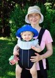 Bebê no estilingue imagens de stock royalty free
