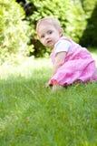 Bebê no jardim Fotografia de Stock Royalty Free