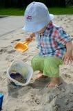 Bebê no sandpit Imagem de Stock Royalty Free