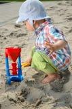 Bebê no sandpit Foto de Stock