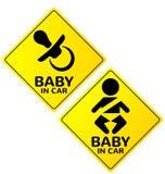 Bebê no sinal do carro Fotografia de Stock Royalty Free