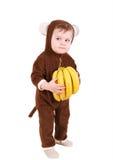 Bebê no traje do macaco com bananas Foto de Stock Royalty Free