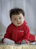 Bebê no vermelho Imagens de Stock Royalty Free