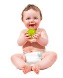 Bebê novo com maçã Fotografia de Stock Royalty Free