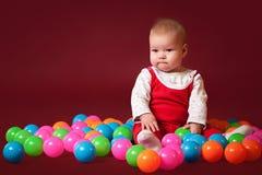Bebê pequeno com bolas Imagem de Stock Royalty Free