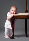 Bebê pequeno com poltrona Imagens de Stock