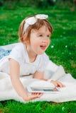 Bebê pequeno com tabuleta Fotos de Stock