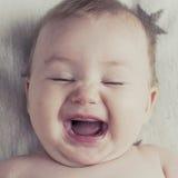 Bebê pequeno de riso, emoções Imagem de Stock