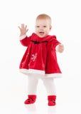 Bebê pequeno no vestido vermelho em um fundo branco Foto de Stock