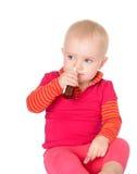Bebé pequeno que pulveriza-se pulverizador de nariz Fotos de Stock