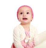 Bebê pequeno surpreendido no fundo branco, olhando acima imagem de stock royalty free