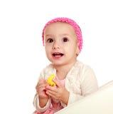 Bebê pequeno surpreendido no fundo branco, olhando acima fotografia de stock