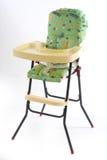 Bebê que come a cadeira Fotografia de Stock