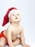 Bebê que desgasta o chapéu de Papai Noel Fotos de Stock Royalty Free