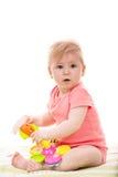 Bebê que joga com brinquedos Imagem de Stock Royalty Free