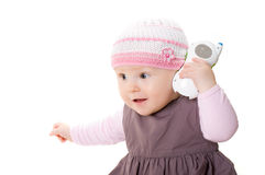 Bebê que joga com o telefone. imagem de stock