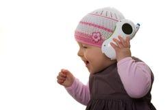 Bebê que joga com o telefone. imagens de stock royalty free