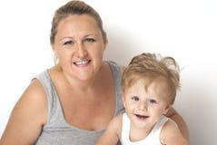 Bebê que joga com sua mamã Imagens de Stock Royalty Free