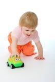 Bebê que joga com um carro do brinquedo Imagem de Stock Royalty Free