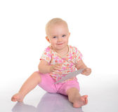 Bebê que joga com uma imagem no fundo branco Imagens de Stock Royalty Free