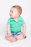 Bebê que olha à esquerda Fotos de Stock
