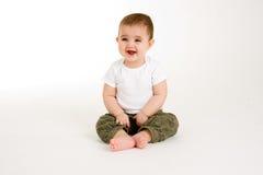 Bebê que olha algo engraçado Imagem de Stock Royalty Free