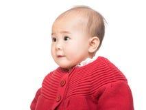 Bebê que olha de lado imagens de stock