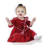 Bebê que puxa Coração-cordas Foto de Stock
