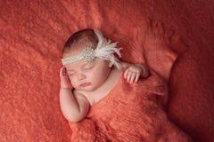 Bebê que veste uma faixa do Flapper do cristal de rocha Fotografia de Stock