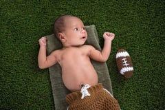 Bebê recém-nascido com futebol imagens de stock royalty free