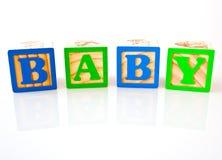 BEBÊ soletrado em blocos de madeira Fotografia de Stock Royalty Free