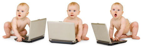 Bebê três nos tecidos com os portáteis no branco Fotos de Stock Royalty Free
