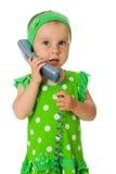 Beb? ador?vel com monofone do telefone Fotografia de Stock