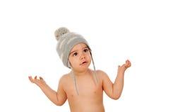 Bebé adorable con el casquillo de las lanas Imagen de archivo