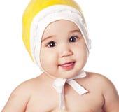 Bebé asiático em um tampão amarelo Imagem de Stock Royalty Free