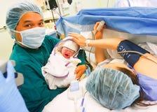 Bebê carregado asiático novo Foto de Stock